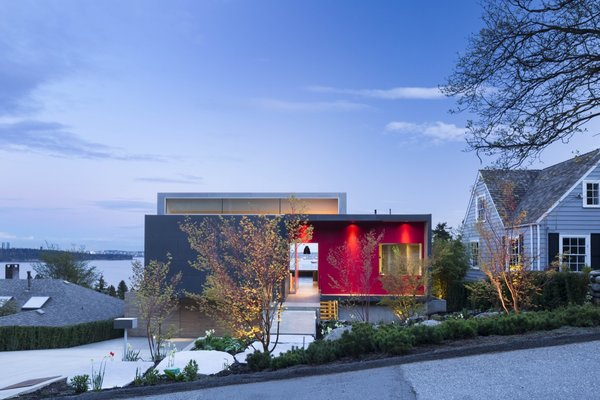 In contrast to their former house that had been set on a flat, densely wooded lot, the clients picked a steeply sloped West Vancouver property with sweeping panoramic views.