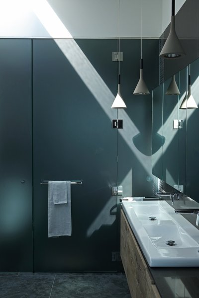 The integrated sink/counter is also by Laufen. The plumbing fixtures are by Zuchetti.