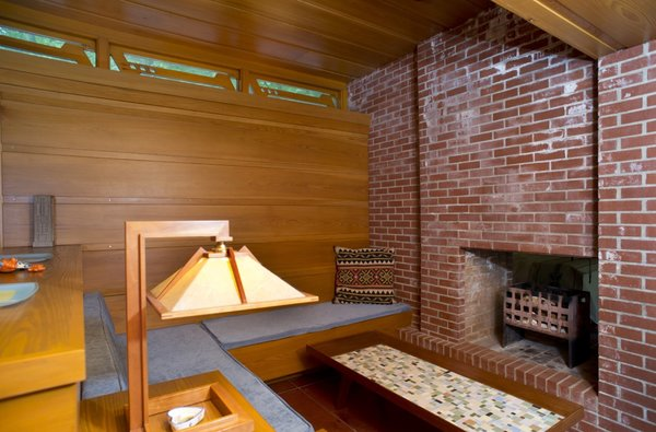 Tarantino Architect's extension includes a heightened clerestory lounge with built-in seating. Great care was taken to match the original materials and details.