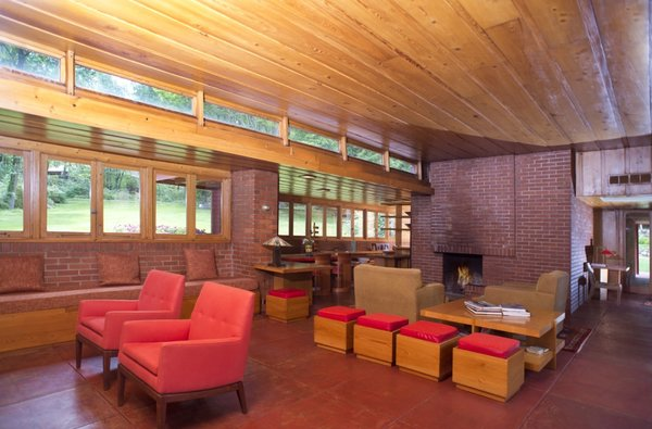 The south side of the living areas are lined with clerestory windows and casement windows. Also pictured is one of two fireplaces in the home.