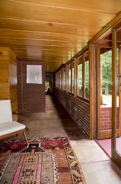 The loggia connects to a long passageway leading to the bedroom wing with the recent master suite addition at the end.