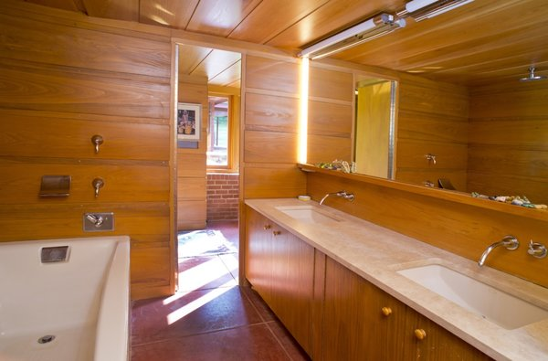 The master bath includes a double vanity as well as a jacuzzi tub with rain shower.