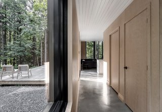 The technical rooms and storage are located behind the kitchen. Large windows and a natural material palette create a seamless feel between the indoors and out.