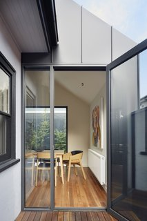 The glazing and doors are double-glazed Capral 400 series aluminum.