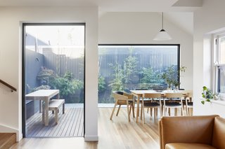 Large walls of glass let plenty of natural light and views into the expanded home.