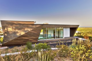 Located on the far end of Provincetown, Massachusetts, the Beach House boasts 2,400 square feet of prime waterfront real estate within a sculptural, timber-clad volume inspired by the landscape.
