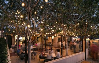 Shaded by canopy trees, the expanded patio offers outdoor dining and creates curb appeal for the restaurant's corner location.