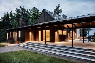 """""""The roof that connects the two volumes makes it possible to use the patio even when it rains or when the dew settles,"""" note the architects. """"This way the house is adapted for Swedish summer— it works in all kinds of weather."""""""