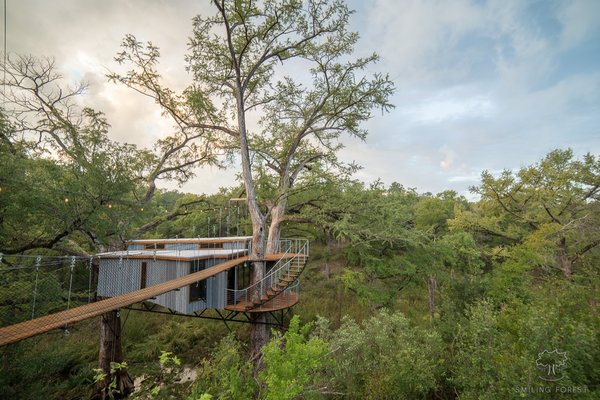 """The roof is standing-seam galvanized metal and the siding is Thermory driftwood. """"The exteriors we drew from the color's of the trees and surrounding rock cliffs to come up with a grey driftwood look,"""" says Will about his choice of siding."""