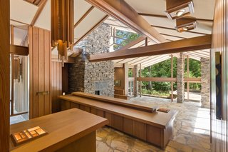 Wrapped in cypress wood inside and out, the home embodies the principles of organic architecture.