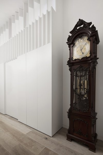 A glimpse inside the entry hallway anchored by a grandfather clock.