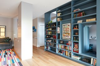 On the basement level, the Megacabinet shelving is mainly used for books and toys. The floors throughout the home are engineered white oak.