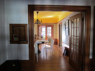 A before image shows the home's main living areas received scant natural light.