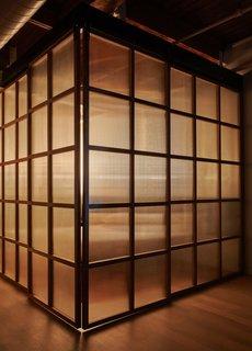 The bedroom enclosure illuminated at night.
