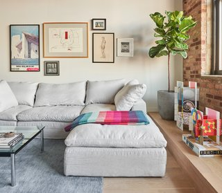 The sectional is from Restoration Hardware, while the rug is by BluDot.