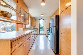 The home's midcentury details are still intact, save for the flooring, appliances, and Formica countertops which have been replaced.
