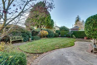 The home's landscaping has been meticulously cared for and preserved.