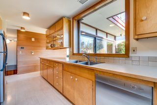 A large window over the sink overlooks the backyard and gives the room a spacious feel.