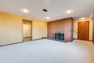 A second fireplace can be found in the downstairs recreation room.