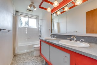 The upstairs bathroom includes a double vanity.