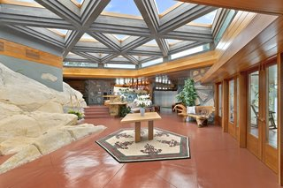 The 26 triangular skylights—covering a total area of 1,500 square feet—in the home are domed, although Wright would most likely have chosen flat skylights. Massaro reportedly said he did not choose flat skylights due to their propensity to leak.