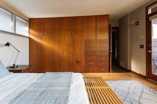 The cabinets in the bedrooms and hallway are built from teak.