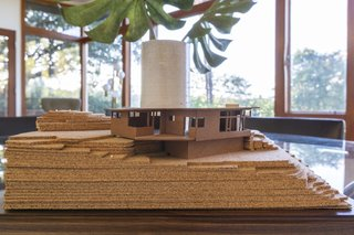 A laser-cut model of the home. The recently added rear deck is not shown.