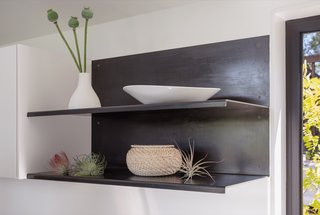 Wittman Estes designed the raw carbon steel shelving, fabricated by Sparrow Woodworks.