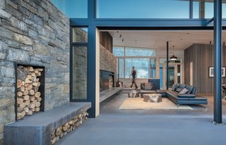 Custom sliding doors extend the living areas to the outdoors.
