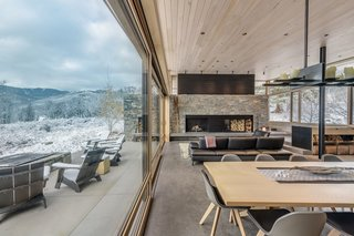 The massive wood-burning hearth is built of Mountain Ash granite with a shou sugi ban accent above.