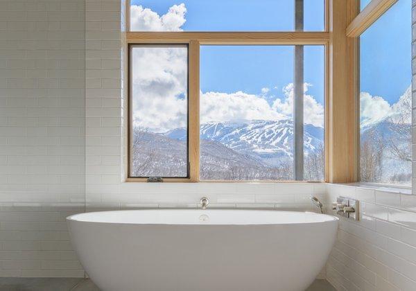 A Victoria + Albert Barcelona tub overlooks stunning landscape views.
