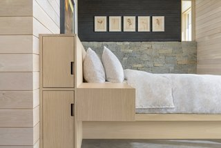 Built-in storage and blonde wood contributes to the home's sleek and minimalist appearance.
