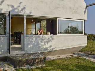 The clients' request for a mouse-proof house informed the shape of the home and the use of cast concrete for the foundation.
