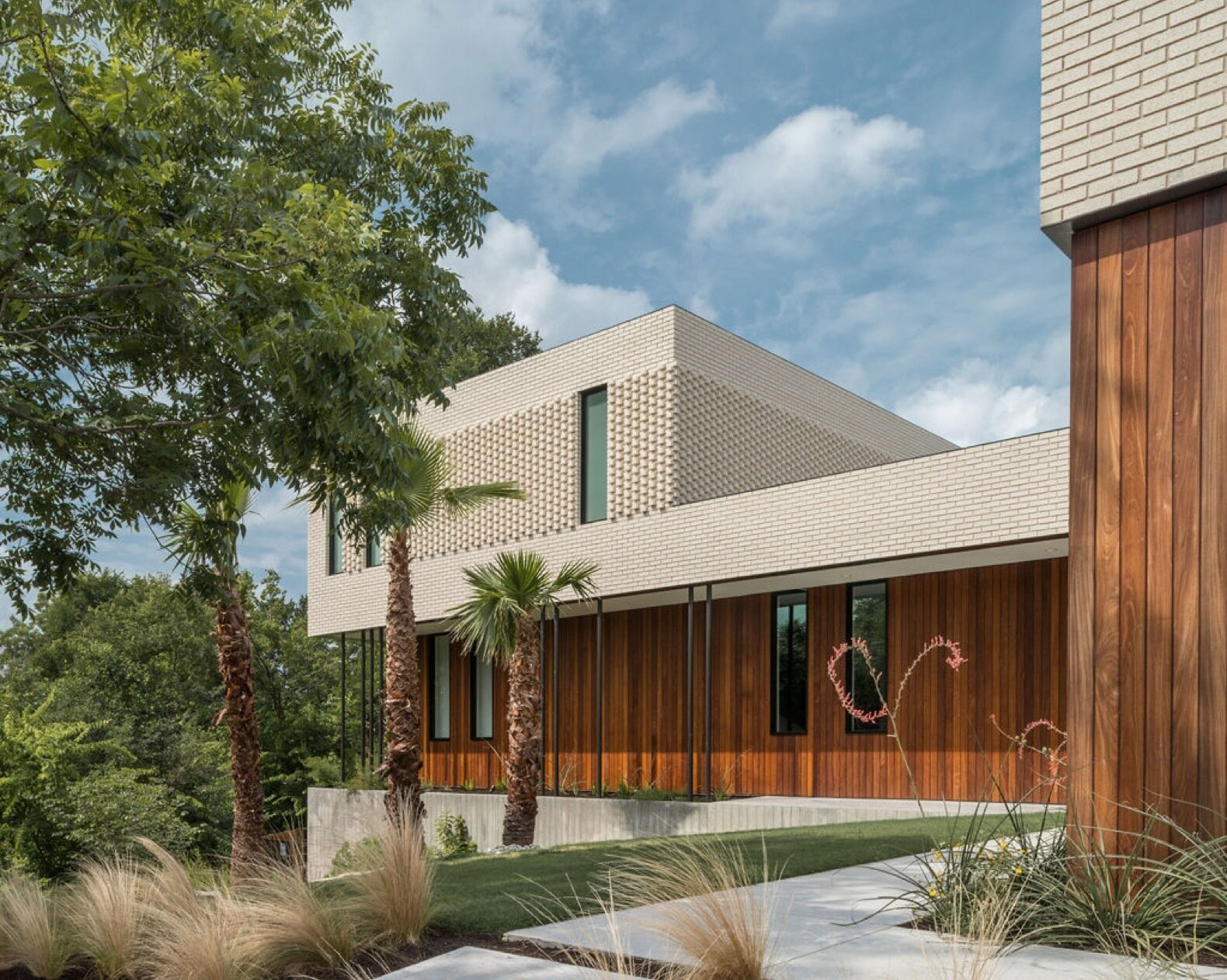 Exterior, Brick Siding Material, House Building Type, and Wood Siding Material  Photo 1 of 9 in 9 Stunning New Homes in Austin Will Open Their Doors for a Virtual Tour