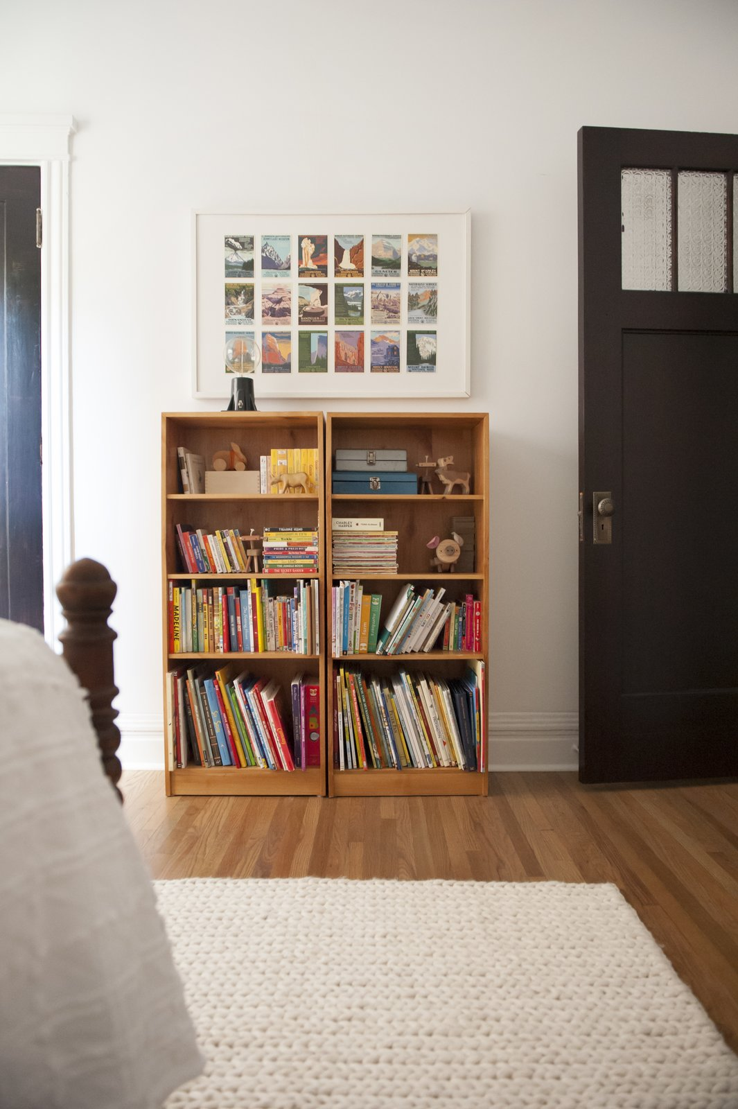 Kids Room, Bedroom Room Type, Bookcase, Medium Hardwood Floor, Rug Floor, Pre-Teen Age, and Neutral Gender  Photos from Simple and Beautiful Chicago Family Apartment