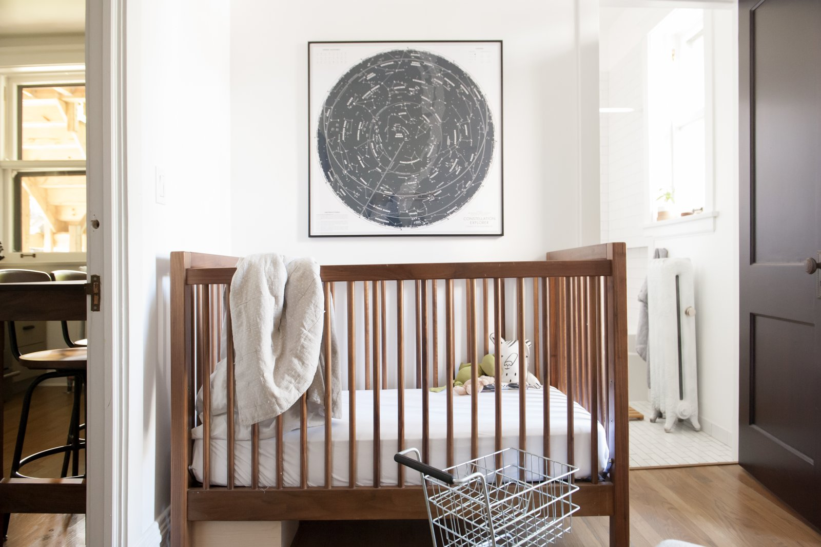 Kids Room, Bedroom Room Type, Bed, Medium Hardwood Floor, Neutral Gender, and Toddler Age  Best Photos from Simple and Beautiful Chicago Family Apartment