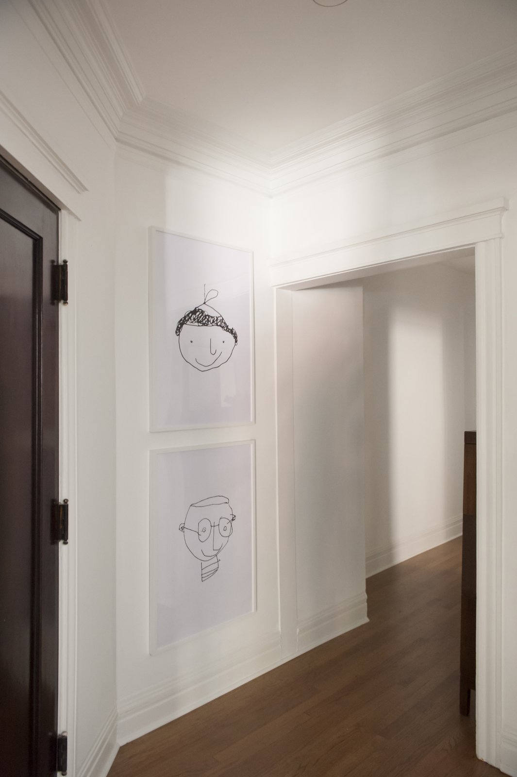 Hallway and Medium Hardwood Floor  Best Photos from Simple and Beautiful Chicago Family Apartment