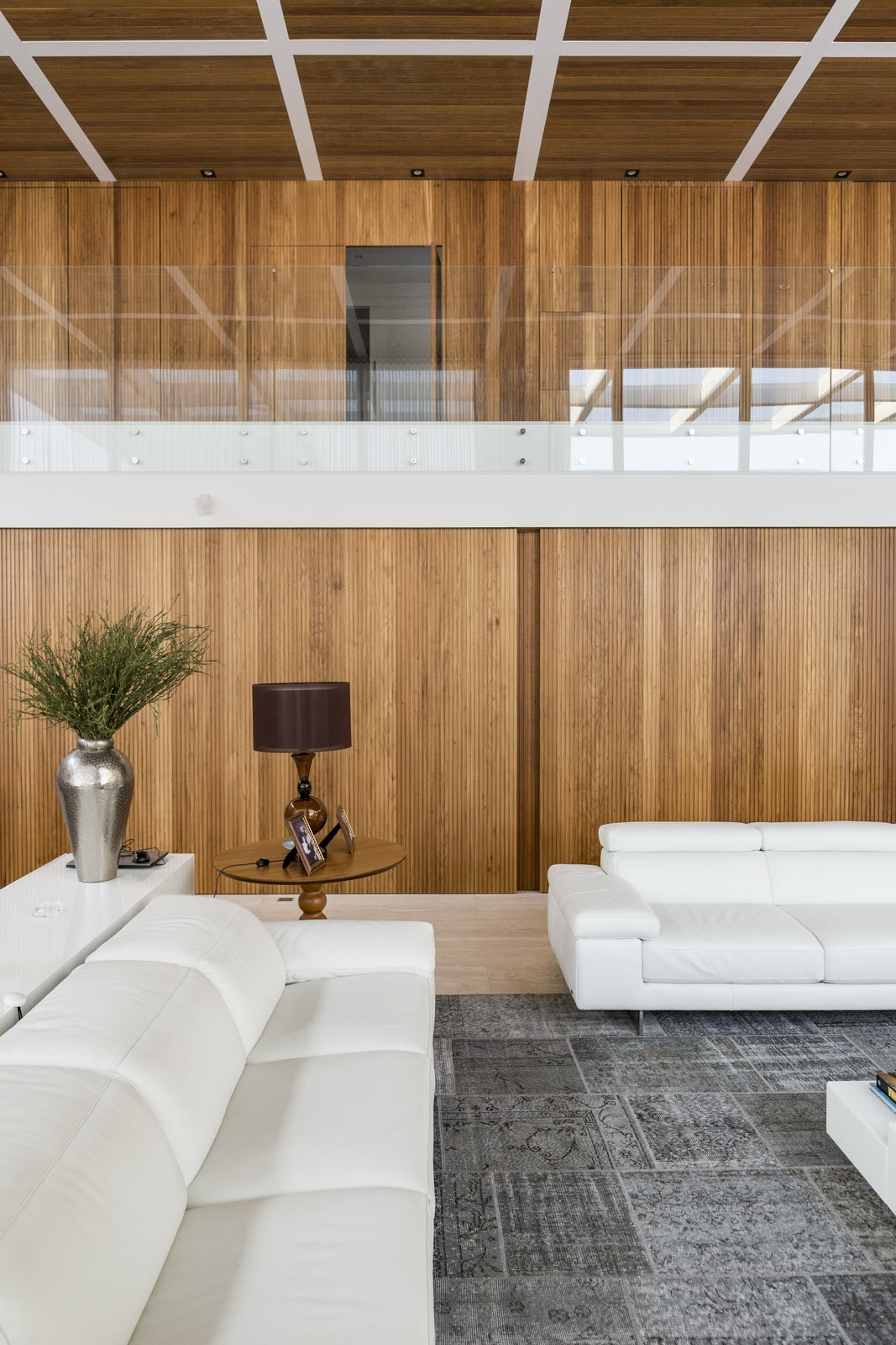 Living, Sofa, Coffee Tables, Console Tables, End Tables, Table, Porcelain Tile, Medium Hardwood, and Ceiling  Living Porcelain Tile End Tables Photos from Jardim do Sol House