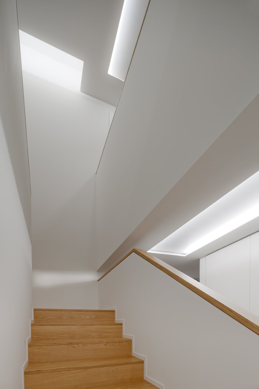 Staircase and Wood Railing Stair  PD House by EXiT architetti associati