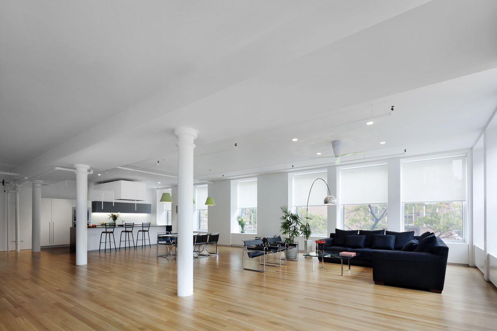 Living Room, Light Hardwood Floor, Recessed Lighting, Chair, Sofa, and Coffee Tables  Spring Street Loft by Verona Carpenter Architects