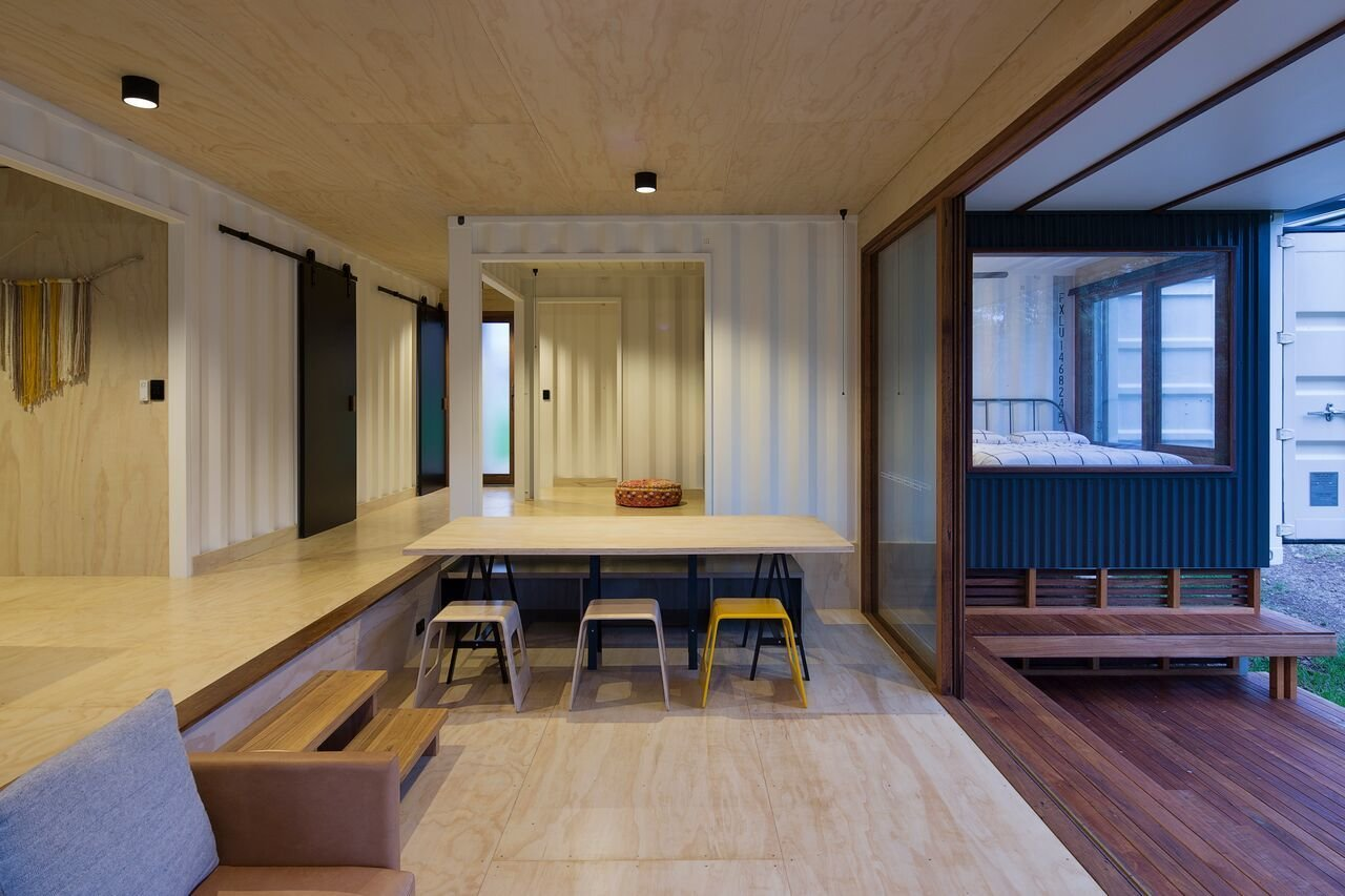 Dining Room, Stools, Light Hardwood Floor, Chair, Ceiling Lighting, and Table  Photo 6 of 10 in A Shipping Container Home in Australia Made With Eco-Friendly Materials