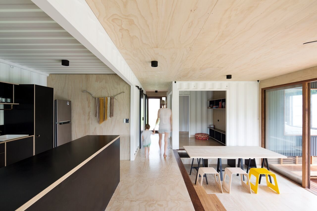 Kitchen, Refrigerator, Drop In Sink, Light Hardwood Floor, Ceiling Lighting, Wood Cabinet, and Open Cabinet  Photo 8 of 10 in A Shipping Container Home in Australia Made With Eco-Friendly Materials
