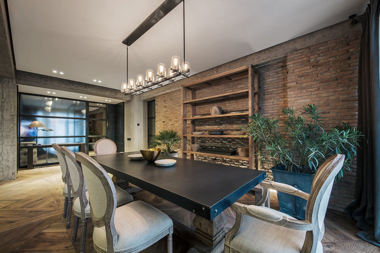 Dining Room, Pendant Lighting, Chair, Storage, and Table  Rustic style apartment in Georgia by YODEZEEN