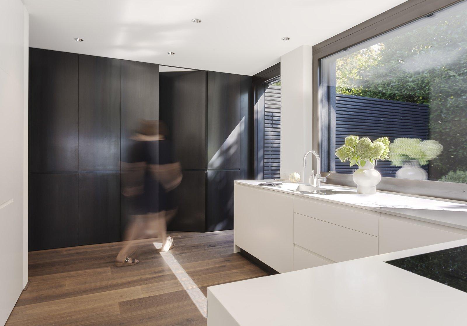 Kitchen, White Cabinet, and Medium Hardwood Floor  Object 336 - beautiful blackbox by meier architekten zurich