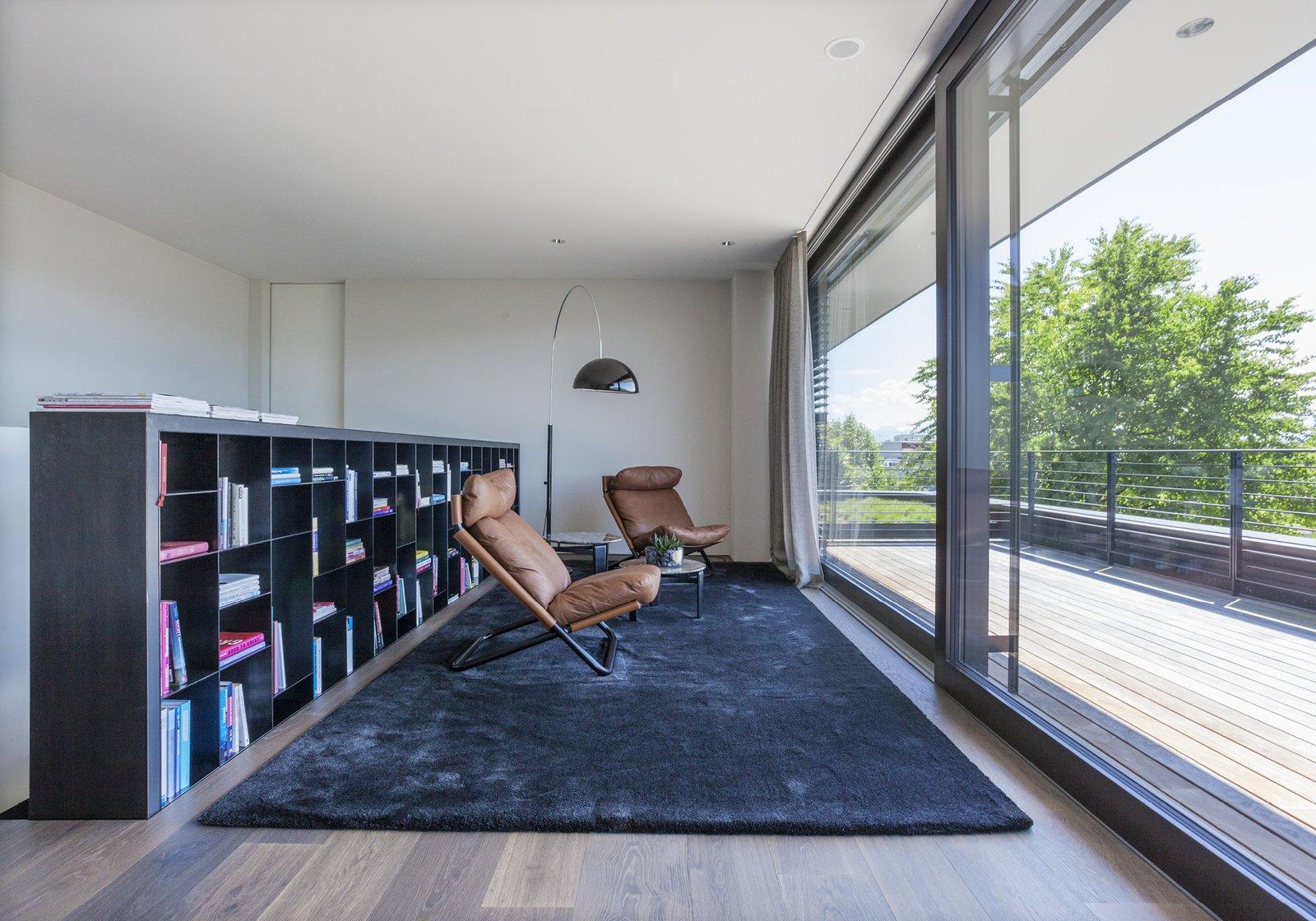 Living Room, Bookcase, Chair, and Medium Hardwood Floor  Object 336 - beautiful blackbox by meier architekten zurich