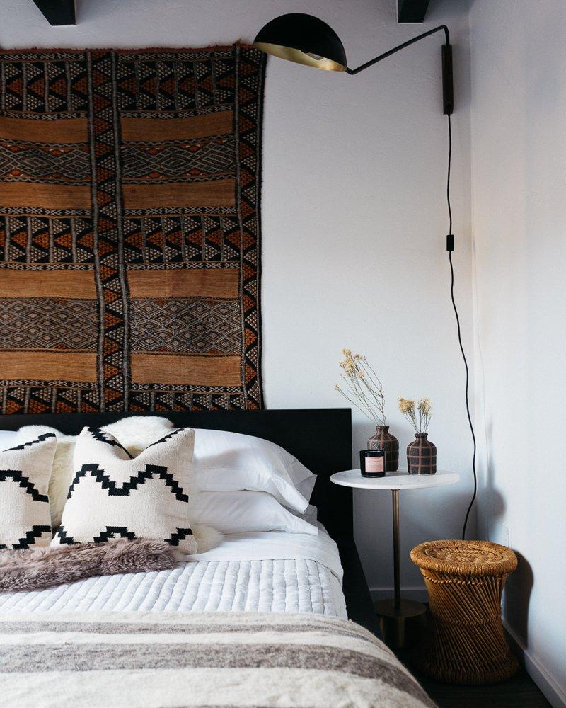 Bedroom, Bed, Wall Lighting, and Dark Hardwood Floor  Big Bear A-Frame Receives Boho Eclectic Transformation
