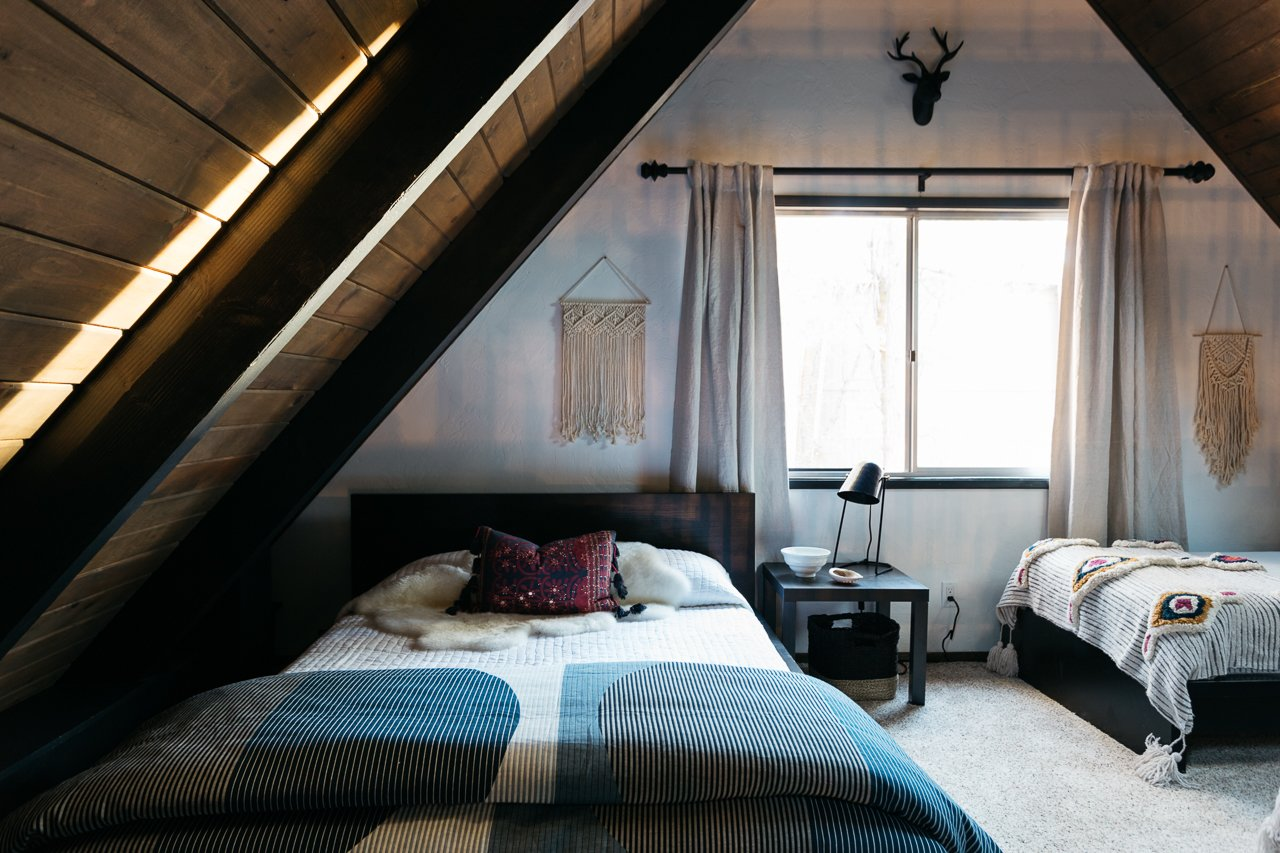 Bedroom, Bed, Carpet Floor, Night Stands, and Table Lighting  Big Bear A-Frame Receives Boho Eclectic Transformation