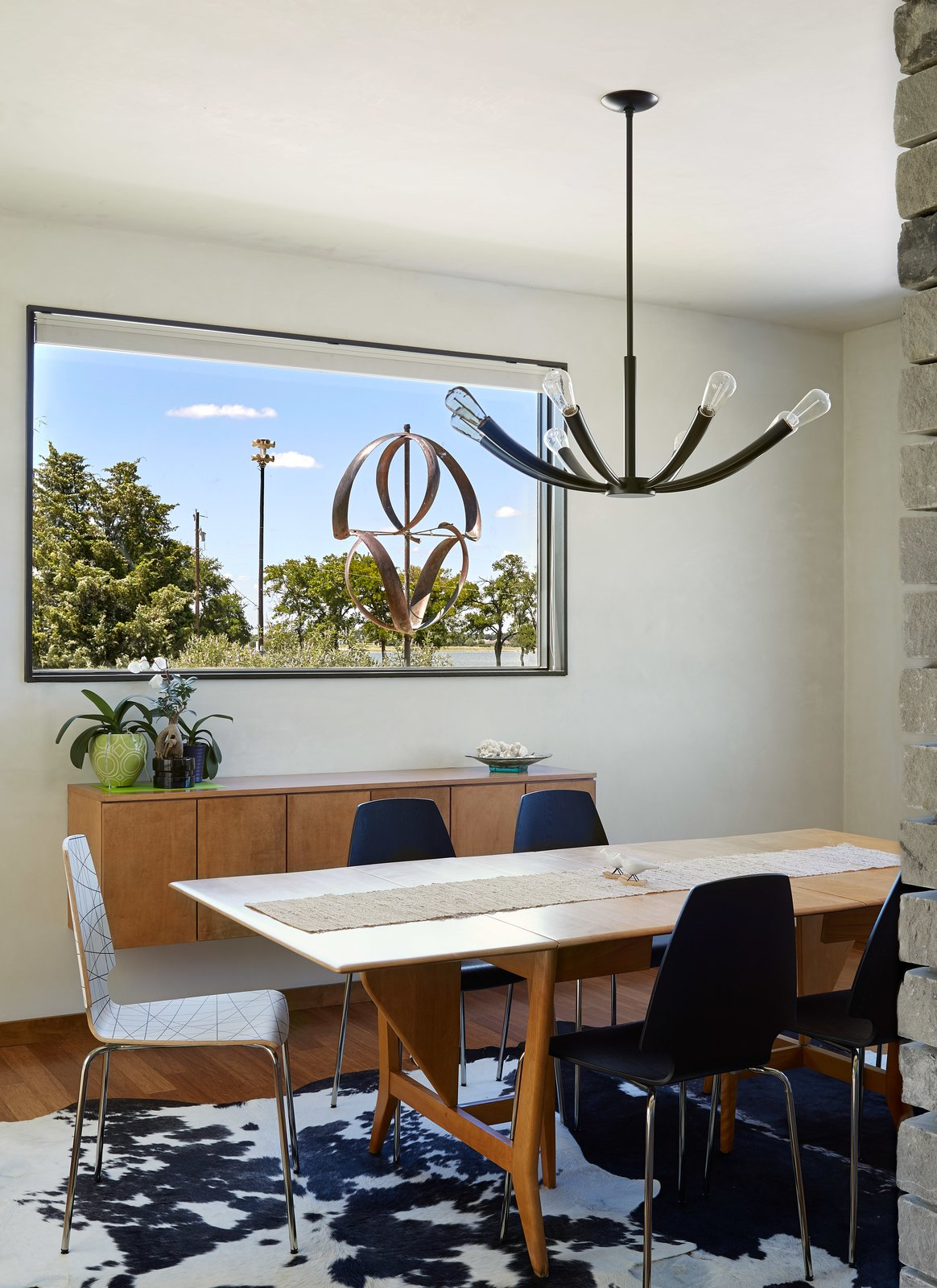 Dining Room, Medium Hardwood Floor, Ceiling Lighting, Table, Chair, and Storage  Lake Waxahachie Home by Mark Odom Studio