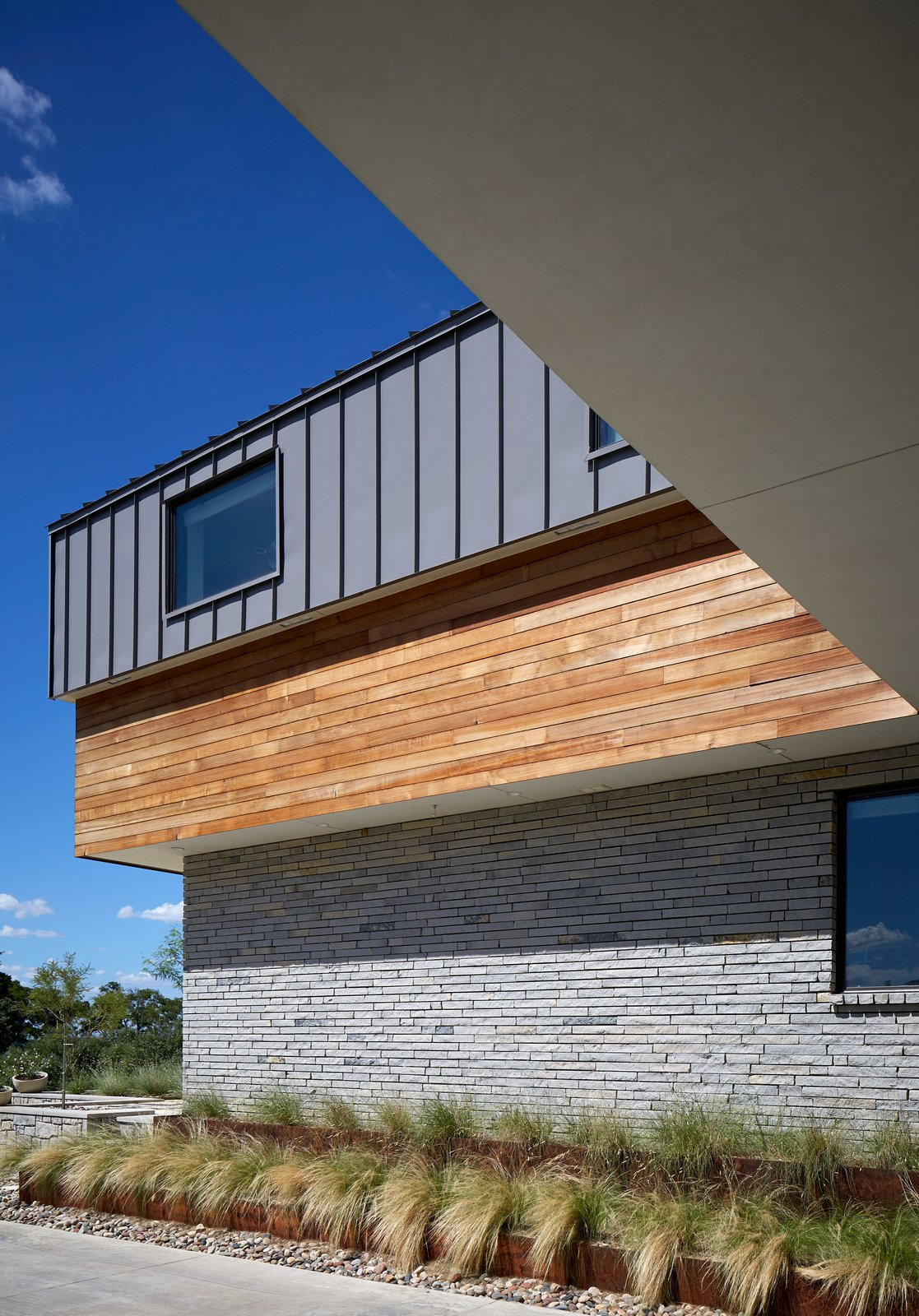 Exterior, Metal Siding Material, House Building Type, Wood Siding Material, and Brick Siding Material  Lake Waxahachie Home by Mark Odom Studio