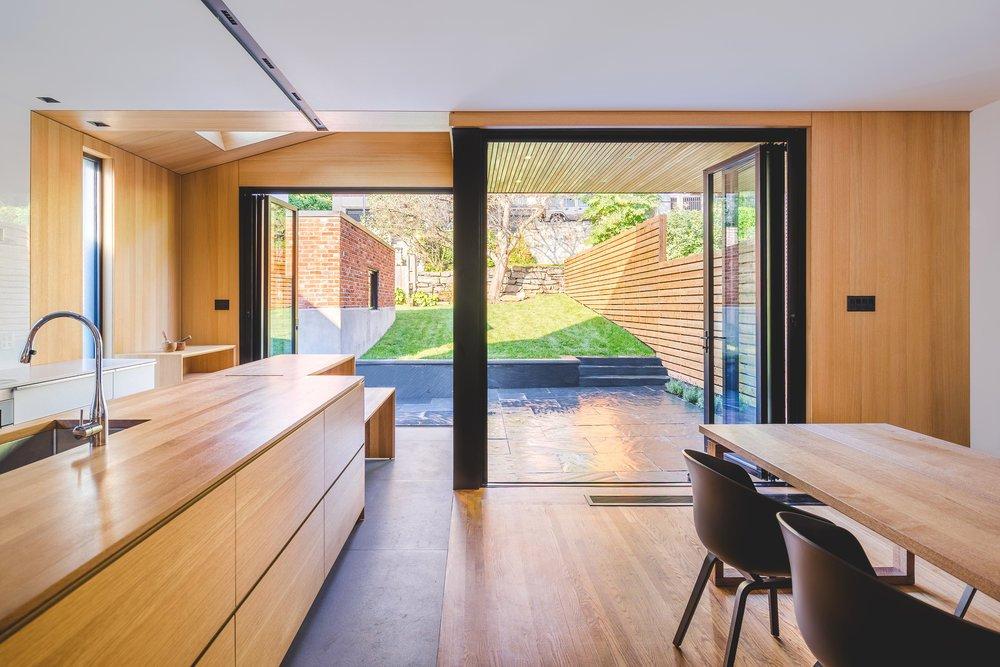 Tagged: Kitchen, Medium Hardwood Floor, and Wood Counter.  Black Box II